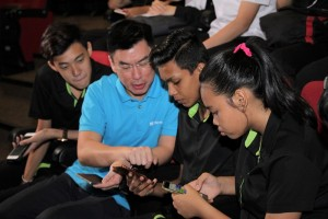 A Microsoft instructor shows ITE College West students how to build apps through Touch Develop, an interactive programming environment developed by Microsoft Research