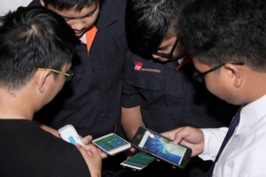 Students from ITE College West creating their own apps at Microsoft's Code for Change workshop